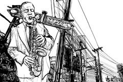 Saxophone player in a street Stock Image