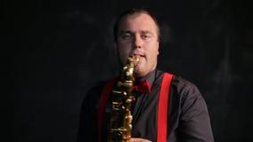 Saxophone player vintage retro style. Vintage retro style musician playing saxophone stock footage