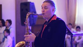 Saxophone player at work stock footage