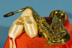 Saxophone and Pointe Shoes Royalty Free Stock Photos