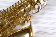 Saxophone. A saxophone on a set of white staves Royalty Free Stock Photo