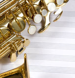 Saxophone. A saxophone on a set of white staves Stock Photo