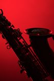 Saxophone Silhouette on Red Stock Image