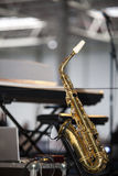 Saxophone on the stage before a concert Stock Photos