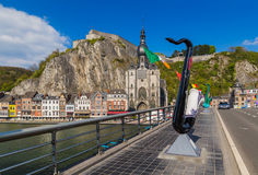 Saxophone statue in Dinant - Belgium. Architecture background Stock Photo