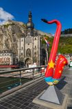 Saxophone statue in Dinant - Belgium. Architecture background Royalty Free Stock Photography