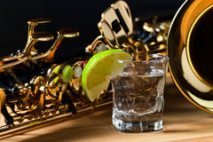 Saxophone and tequila with lime Stock Photo