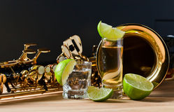 Saxophone and tequila with lime Stock Images