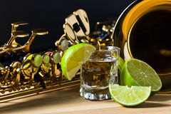 Saxophone and tequila with lime Stock Image
