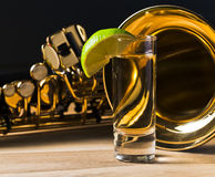 Saxophone and tequila with lime Royalty Free Stock Image