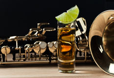 Saxophone and tequila with lime Stock Photos