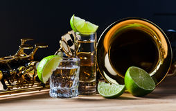 Saxophone and tequila with lime Royalty Free Stock Photo
