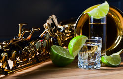 Saxophone and tequila with lime Royalty Free Stock Photos