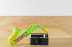 Saxophone toy and vintage camera Stock Photography