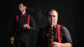 Saxophone and trumpet players vintage retro style. Musicians stock video footage