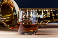 Saxophone and whiskey Stock Photos