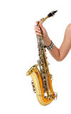 Saxophone in the women's hand. On the white background Royalty Free Stock Photos