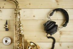 Saxophone on the Wood Background Royalty Free Stock Image