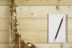 Saxophone on the Wood Background Stock Photos