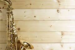 Saxophone on the Wood Background Stock Photo
