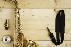 Saxophone on the Wood Background. With strap, mouse and mute Stock Image