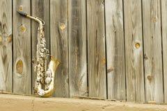 Saxophone Wooden fence Stock Photo