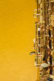 Saxophone. On the yellow background Royalty Free Stock Images