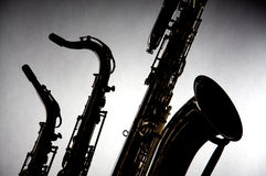Saxophones Isolated in Silhouette Royalty Free Stock Image