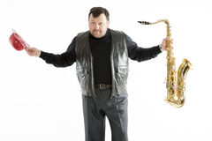 Saxophonist with a bristle Royalty Free Stock Photos