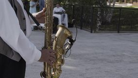 Saxophonist in dinner jacket play on golden saxophone. Live performance. Jazz music.  stock footage