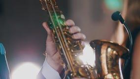 Saxophonist in dinner jacket play on golden saxophone. Performance. Jazz artist. Music stock video