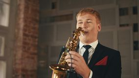 Saxophonist in dinner jacket play on golden saxophone at stage. Jazz vocalist stock video