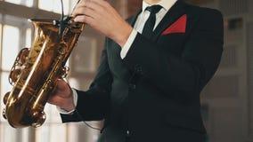 Saxophonist in dinner jacket step in on stage. Jazz artist. Performing. Elegance stock video footage