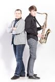 Saxophonist and DJ posing in studio Stock Photo