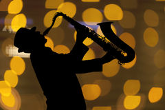 Saxophonist. Man playing on saxophone Royalty Free Stock Photography