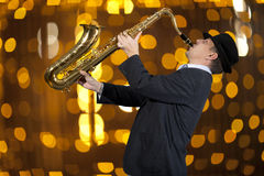 Saxophonist. Man playing on saxophone Stock Photos