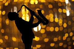 Saxophonist. Man playing on saxophone Stock Photo