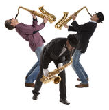 Saxophonist. Middle aged man playing on saxophone isolated on background Stock Photography
