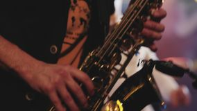 Saxophonist play on golden saxophone. Live performance. Jazz artist. Spotlights. stock footage