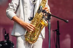 Saxophonist Playing At A Jazz Festival In A City Park Royalty Free Stock Images