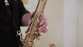 Saxophonist playing music at event. Saxophonist playing sax music at event stock video footage