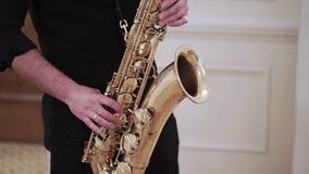Saxophonist playing music at event. Saxophonist playing sax music at event stock video