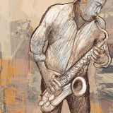 Saxophonist playing saxophone on grunge background Royalty Free Stock Image