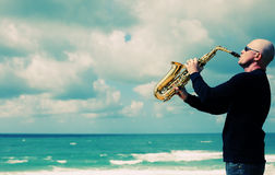 Saxophonist. Playing on saxophone outdoor. Old style photo Stock Image
