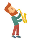 Saxophonist playing in the street Royalty Free Stock Photos