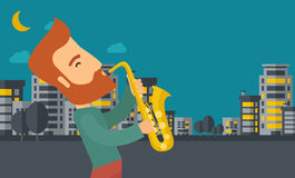 Saxophonist playing in the streets at night Royalty Free Stock Photo