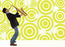 Saxophonist. Portrait of a man playing on saxophone Royalty Free Stock Photos