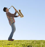 Saxophonist. Portrait of a man playing on saxophone Stock Photography
