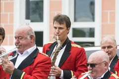 Saxophonist in a red tunic Stock Images