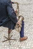 Saxophonist with saxophone on the street royalty free stock images